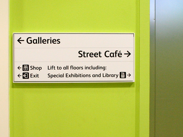 Interior sign in gallery entrance threshold