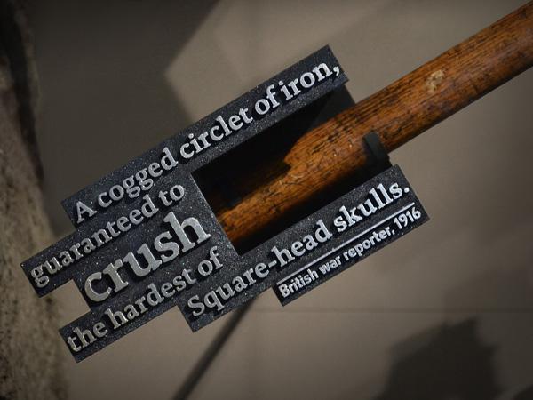 Quote cast in metal. Hand to Hand Combat display.