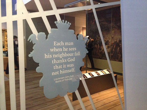 Quote within a cartouche printed onto a mirror